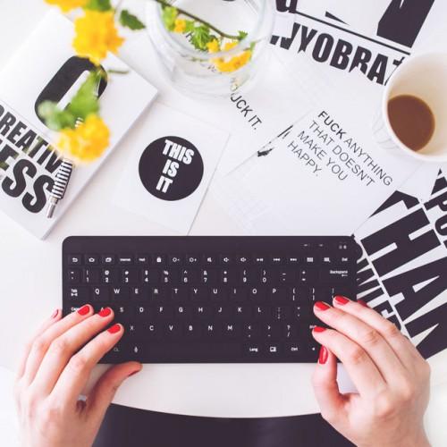 fingers writing on a keyboard creativity
